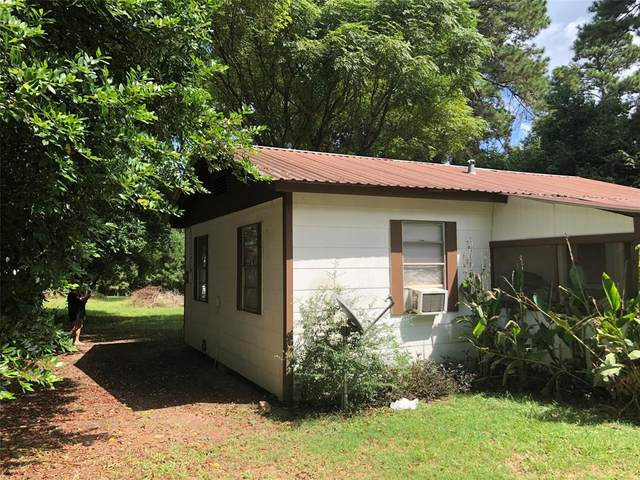 1411 State Highway 150, Coldspring, TX 77331 (MLS #8873684) :: My BCS Home Real Estate Group