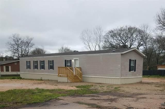 310 S Pine Circle, Pinehurst, TX 77362 (MLS #92502233) :: Texas Home Shop Realty