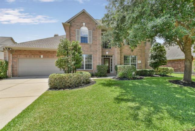 15819 Lake Loop Drive, Cypress, TX 77433 (MLS #12176805) :: The SOLD by George Team