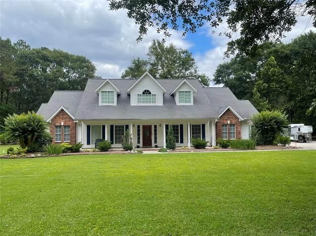 295 Vista Del Lago Drive, Huffman, TX 77336 (MLS #46477715) :: The Home Branch