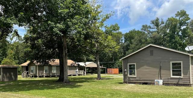 456 County Road 328 N, Cleveland, TX 77327 (MLS #98366845) :: The SOLD by George Team