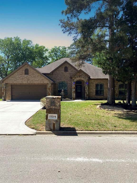 15204 Constellation Circle W, Willis, TX 77318 (MLS #25631611) :: Caskey Realty