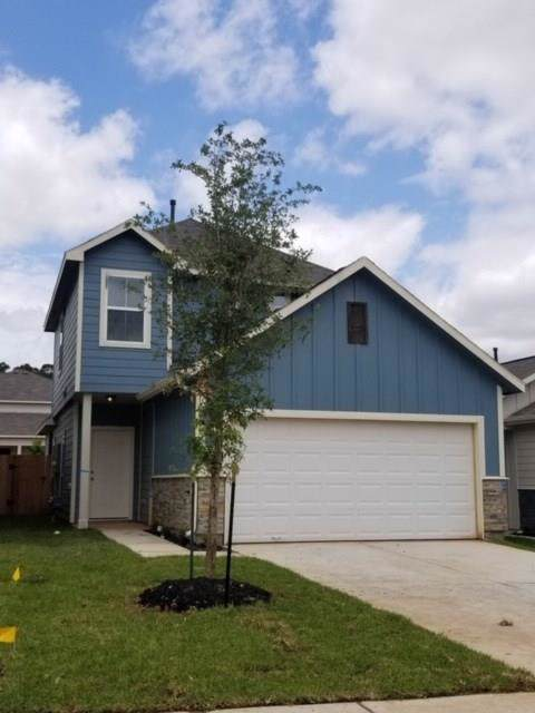 125 Camelot Place Court, Conroe, TX 77304 (MLS #44807967) :: Texas Home Shop Realty