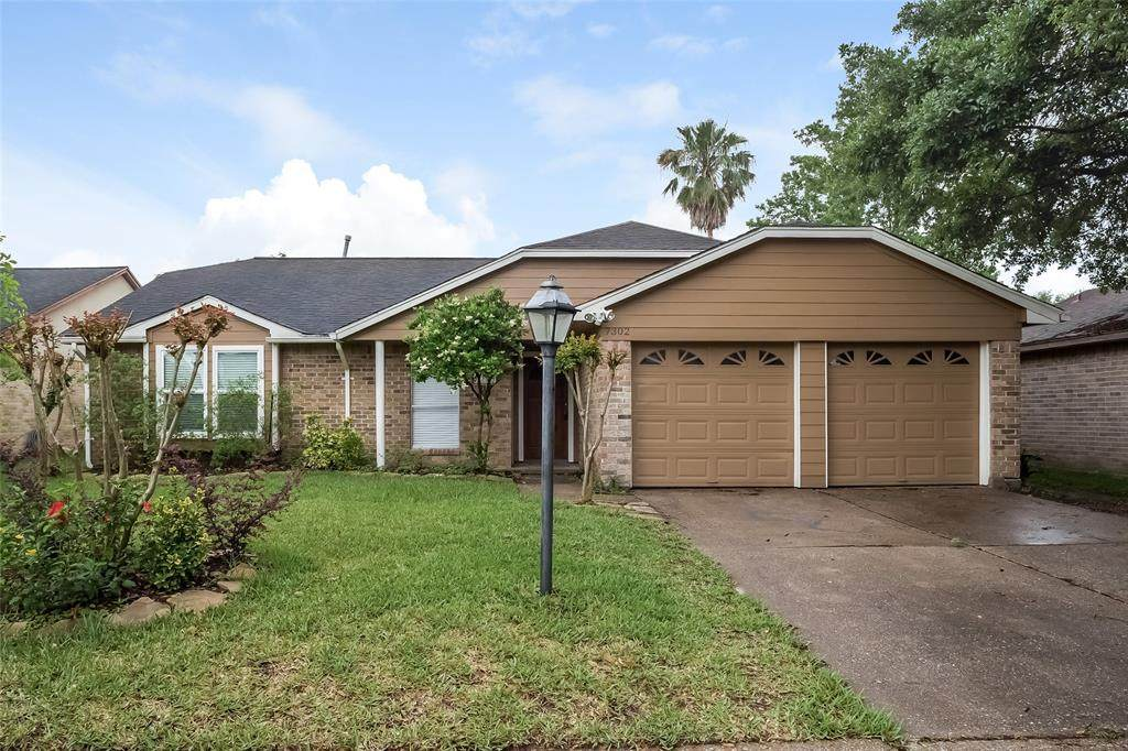 7302 Thicket Trail Drive - Photo 1