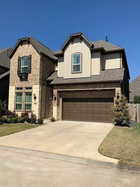 13210 Parkway Spring Drive, Houston, TX 77077 (MLS #71102529) :: Michele Harmon Team