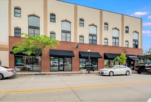 319 SE Douglas Street #208, Lee's Summit, MO 64063 (#2257630) :: Ask Cathy Marketing Group, LLC