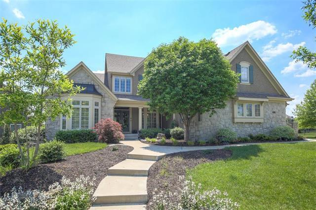 9113 W 156TH Place, Overland Park, KS 66221 (#2107582) :: Edie Waters Network
