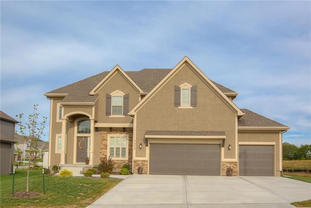 9404 N Cosby Avenue, Kansas City, MO 64154 (#2131823) :: Edie Waters Network