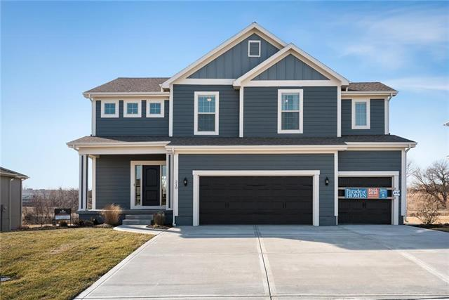 1305 Mission Drive, Raymore, MO 64083 (#2165421) :: House of Couse Group