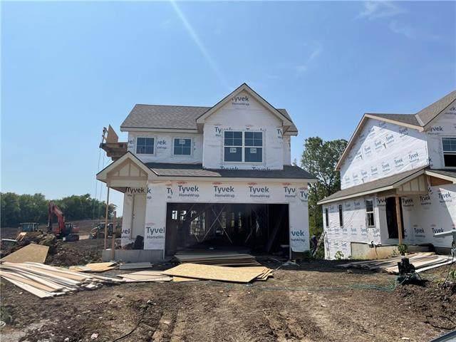1402 Newport Lane, Raymore, MO 64083 (#2339713) :: Austin Home Team