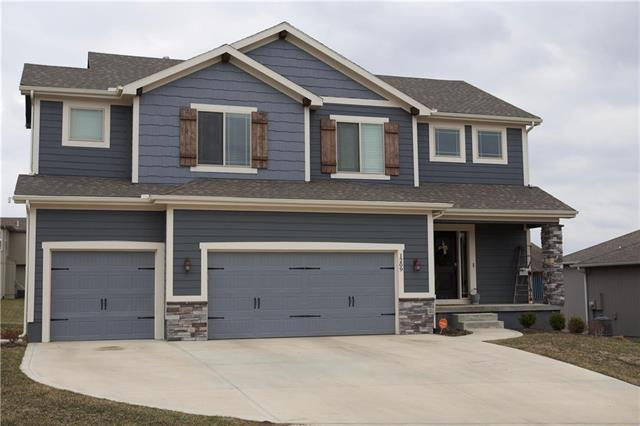 1209 Mission Drive, Raymore, MO 64083 (#2153414) :: Edie Waters Network