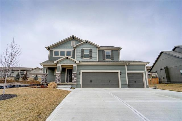 1302 S Mission Drive, Raymore, MO 64083 (#2077521) :: Edie Waters Network
