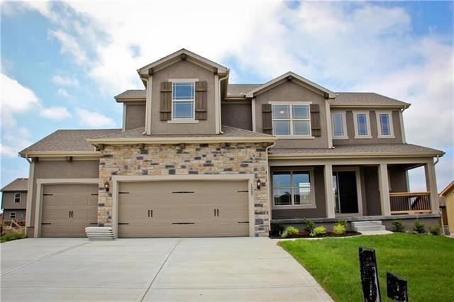 1301 Mission Drive, Raymore, MO 64083 (#2086010) :: Edie Waters Network