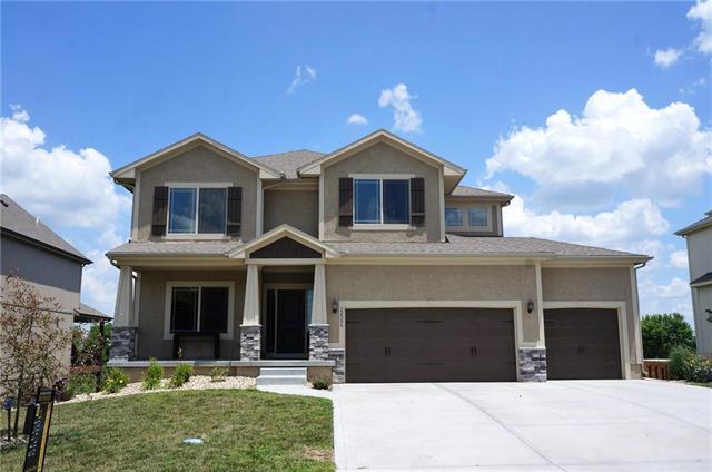 12506 S Fox Den Drive, Lee's Summit, MO 64086 (#2106892) :: Char MacCallum Real Estate Group