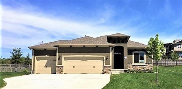 1310 Mission Drive, Raymore, MO 64083 (#2125126) :: House of Couse Group