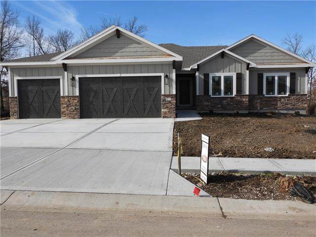 818 NW Hickory Ridge Drive, Grain Valley, MO 64029 (#2235303) :: Edie Waters Network