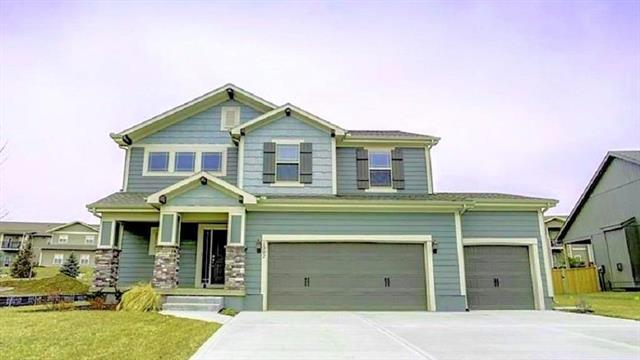 1302 S Mission Drive, Raymore, MO 64083 (#2077521) :: House of Couse Group