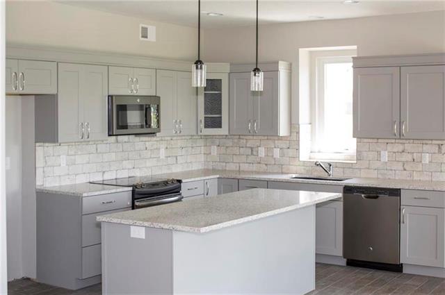 1206 SW 12th Terrace, Louisburg, KS 66053 (#2092157) :: Edie Waters Network