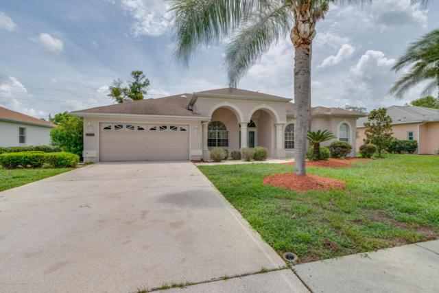 3352 St Ives Boulevard, Spring Hill, FL 34609 (MLS #2184737) :: The Hardy Team - RE/MAX Marketing Specialists
