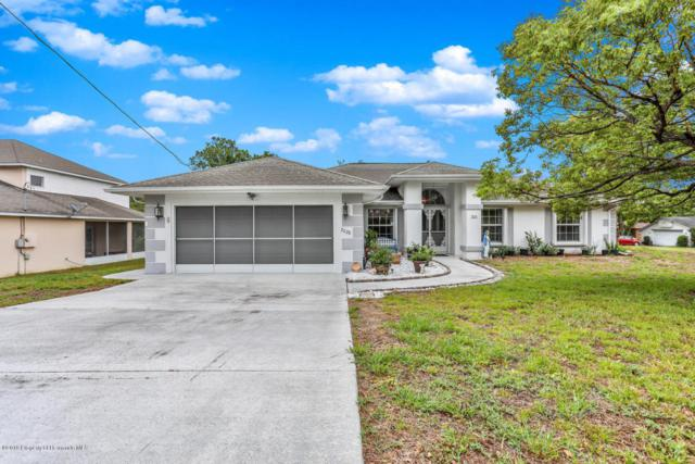 7028 Covewood Drive, Spring Hill, FL 34609 (MLS #2192526) :: The Hardy Team - RE/MAX Marketing Specialists