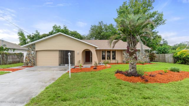 2552 Commerce Avenue, Spring Hill, FL 34609 (MLS #2193225) :: The Hardy Team - RE/MAX Marketing Specialists