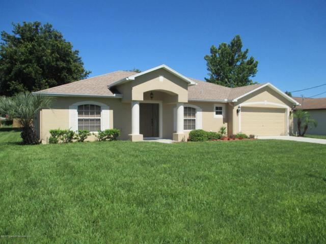 1017 Concert Avenue, Spring Hill, FL 34609 (MLS #2193679) :: The Hardy Team - RE/MAX Marketing Specialists