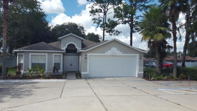 14301 Spring Hill Drive, Spring Hill, FL 34609 (MLS #2195760) :: The Hardy Team - RE/MAX Marketing Specialists