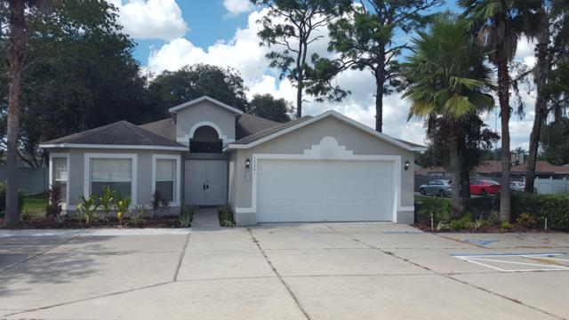 14301 Spring Hill Drive, Spring Hill, FL 34609 (MLS #2197195) :: The Hardy Team - RE/MAX Marketing Specialists