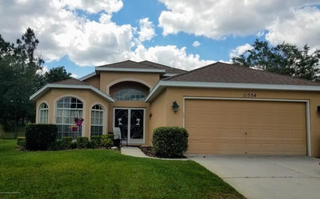 11554 New Haven Drive, Spring Hill, FL 34609 (MLS #2200374) :: The Hardy Team - RE/MAX Marketing Specialists