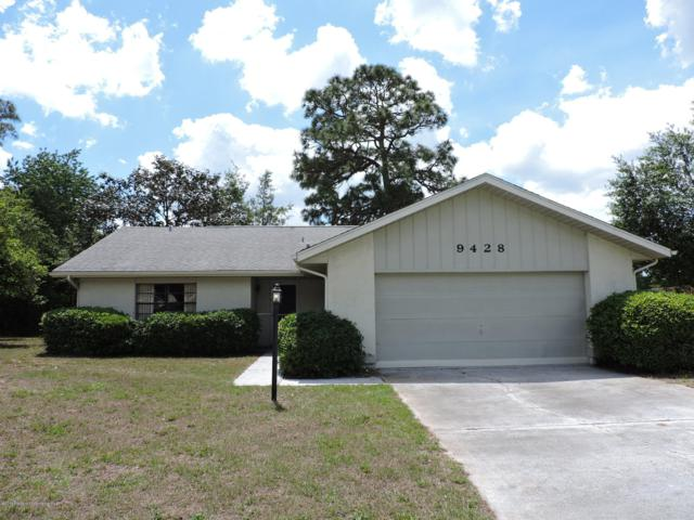 9428 Century Drive, Spring Hill, FL 34606 (MLS #2200401) :: The Hardy Team - RE/MAX Marketing Specialists