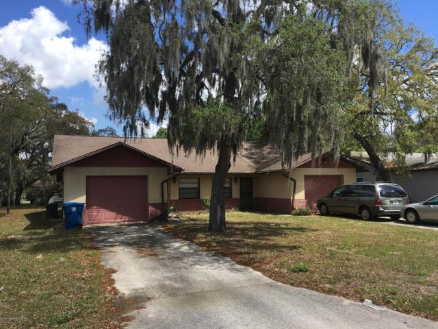 8079-8081 Omaha Circle, Spring Hill, FL 34606 (MLS #2200413) :: The Hardy Team - RE/MAX Marketing Specialists