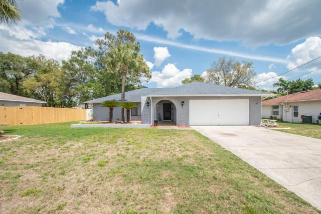 1508 Haulover Avenue, Spring Hill, FL 34608 (MLS #2200430) :: The Hardy Team - RE/MAX Marketing Specialists