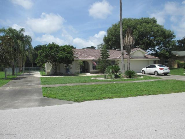 9396 Century Drive, Spring Hill, FL 34606 (MLS #2202145) :: The Hardy Team - RE/MAX Marketing Specialists