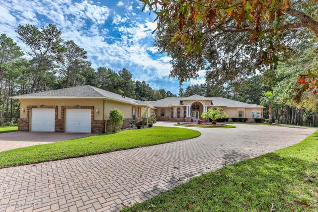 9402 Sand Pines Court, Weeki Wachee, FL 34613 (MLS #2206217) :: The Hardy Team - RE/MAX Marketing Specialists