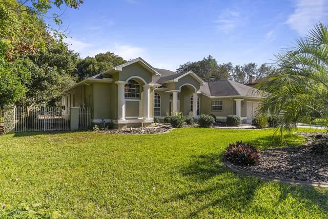 18636 Winding Oaks Boulevard, Hudson, FL 34667 (MLS #2206431) :: The Hardy Team - RE/MAX Marketing Specialists