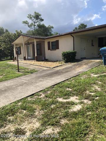 9546 Northcliff, Spring Hill, FL 34608 (MLS #2218609) :: Dalton Wade Real Estate Group