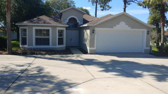 14301 Spring Hill Drive, Spring Hill, FL 34609 (MLS #2191797) :: The Hardy Team - RE/MAX Marketing Specialists
