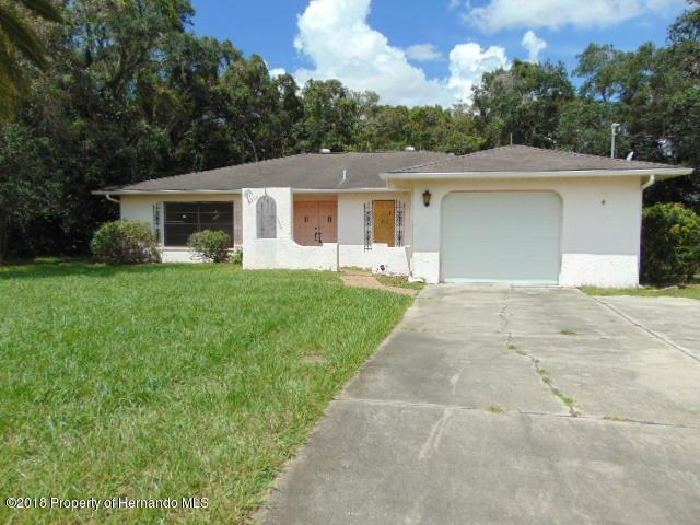 7721 Holiday Drive, Spring Hill, FL 34606 (MLS #2195187) :: The Hardy Team - RE/MAX Marketing Specialists