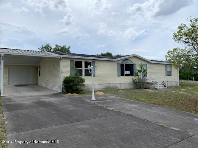 9242 Admiral Street, Brooksville, FL 34613 (MLS #2200267) :: The Hardy Team - RE/MAX Marketing Specialists
