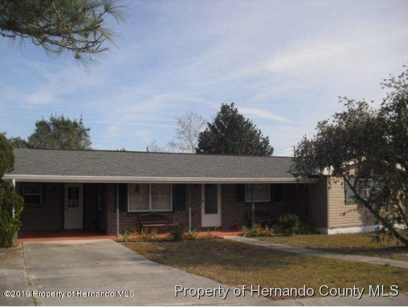 7453 Holiday Drive, Spring Hill, FL 34606 (MLS #2200314) :: The Hardy Team - RE/MAX Marketing Specialists