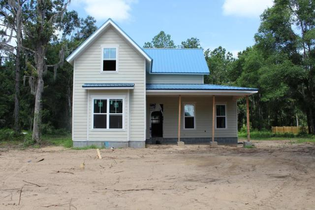 202 Goodman Drive, Midway, GA 31320 (MLS #131555) :: Coldwell Banker Holtzman, Realtors