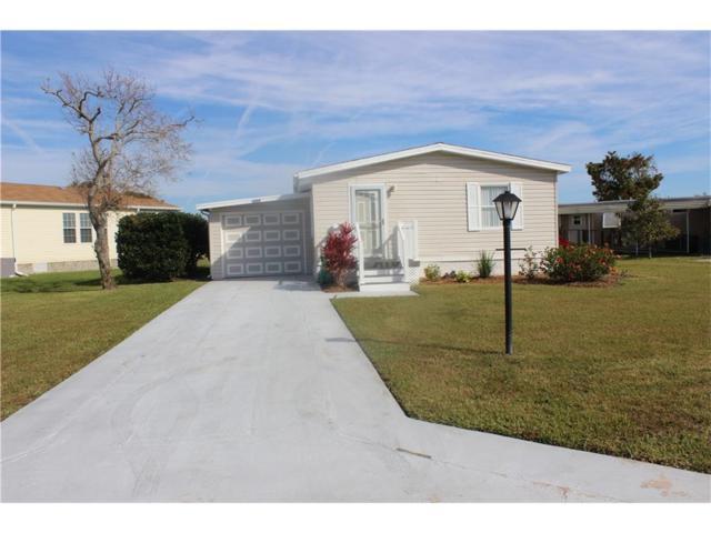 1054 W Barefoot Bay Circle, Barefoot Bay, FL 32976 (MLS #201944) :: Billero & Billero Properties