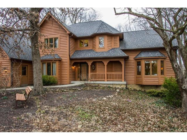 7940 Wooden Drive, Indianapolis, IN 46260 (MLS #21464403) :: Mike Price Realty Team - RE/MAX Centerstone