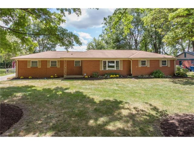 1409 Oakwood Trail, Indianapolis, IN 46260 (MLS #21502758) :: Indy Scene Real Estate Team