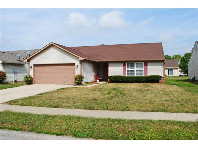 4040 Caddy Way, Indianapolis, IN 46268 (MLS #21513612) :: Indy Plus Realty Group- Keller Williams