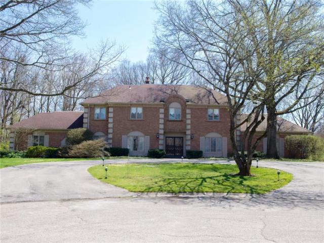 911 Round Table Court, Indianapolis, IN 46260 (MLS #21560152) :: Indy Scene Real Estate Team