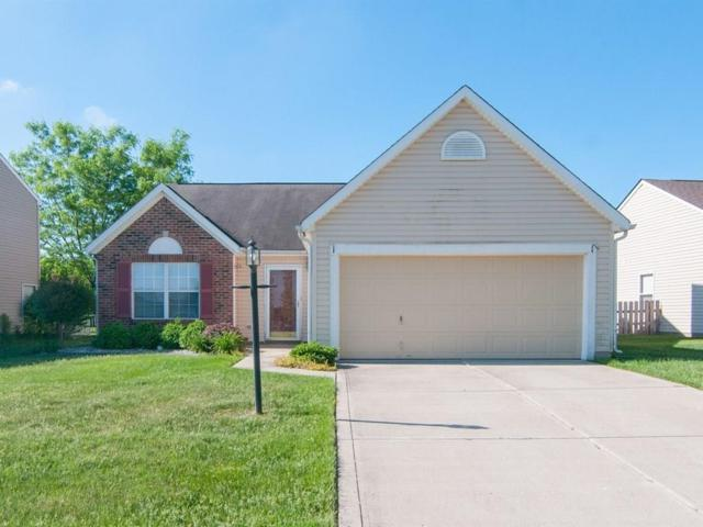 12243 Carriage Stone Drive, Fishers, IN 46037 (MLS #21563392) :: The Evelo Team