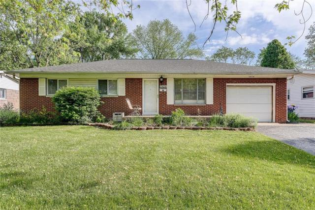 7404 E 49th Street, Lawrence, IN 46226 (MLS #21567048) :: The Evelo Team