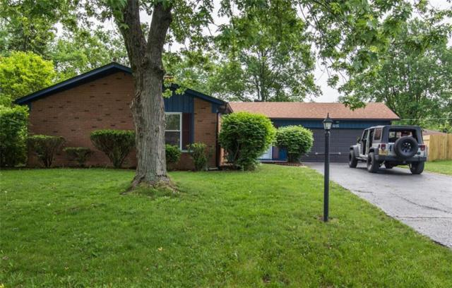 1215 Carroll White Drive, Indianapolis, IN 46219 (MLS #21567179) :: HergGroup Indianapolis