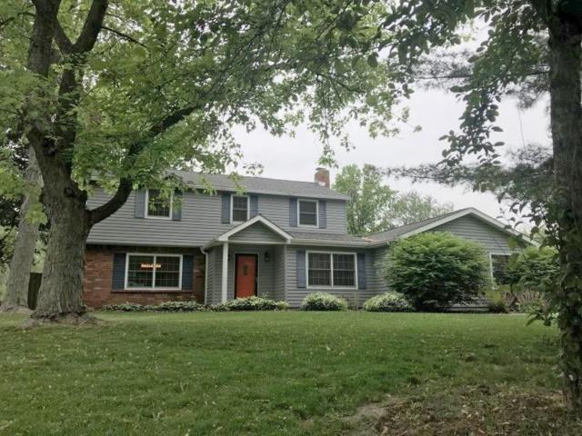 101 Village Dr E, Carmel, IN 46032 (MLS #21574708) :: Indy Scene Real Estate Team
